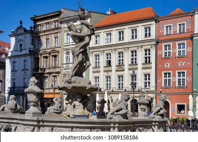 Poznan, Poland, April 30, 2018: Old Market sqaure in Poznan. Poland. Row of colorful old houses in the historical town square. Statue of Proserpina in front the renaissance old city hall