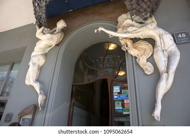 Poznan, Poland, April 30, 2018: Male and female nude sculptures adorn the entrance to the building in Art Nouveau style