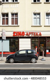 POZNAN, POLAND - AUGUST 26, 2016: Car parked in front of a pharmacy close by the city center