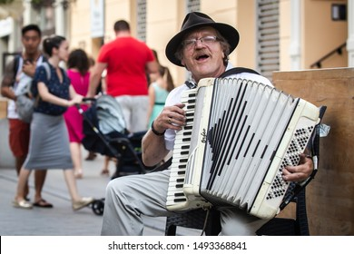 Poznan, Poland - August 31st 2019: An accordion player performing on the street in the city center.
