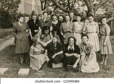 POZNAN, POLAND, CIRCA 1937 - Vintage photo of group of female high school pupils, posing outdoor, Poznan, Poland, circa 1937