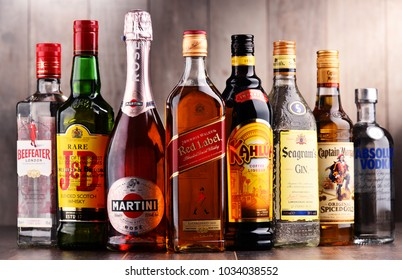 POZNAN, POLAND - DEC 15, 2017: Bottles of assorted global liquor brands including Martini, Johnnie Walker, Captain Morgan, Beefeater, Absolut Vodka, Seagram and others