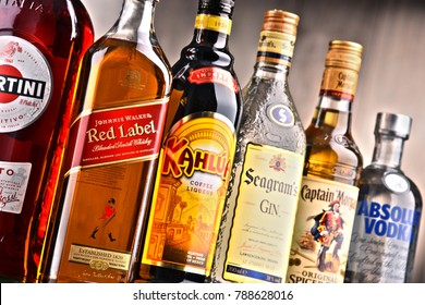 POZNAN, POLAND - DEC 15, 2017: Bottles of assorted global liquor brands including Martini, Johnnie Walker, Captain Morgan, Absolut Vodka, Seagram and Kahlua