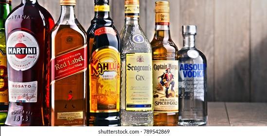 POZNAN, POLAND - DEC 15, 2017: Bottles of assorted global liquor brands including Martini, Johnnie Walker, Captain Morgan, Absolut Vodka, Seagram and Kahlua