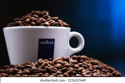 POZNAN, POLAND - DEC 30, 2018: Cup of Lavazza coffee, a brand owned by an Italian manufacturer of coffee products, founded in Turin in 1895 by Luigi Lavazza.