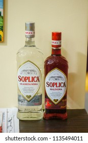 Poznan, Poland - December 23, 2015: Soplia Polish vodka clear and with raspberry flavour in bottles standing on a table