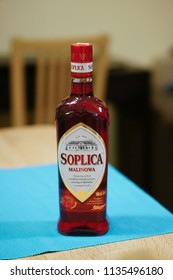 Poznan, Poland - December 23, 2015: Polish Soplica vodka with raspberry flavour standing on a table