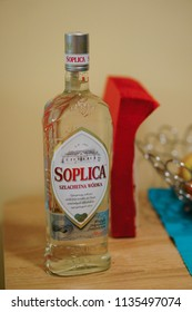 Poznan, Poland - December 23, 2015: Polish Soplica clear vodka in a bottle standing on a table in soft focus