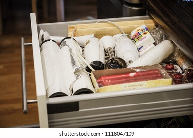 Poznan, Poland - December 30, 2015: Open messy drawer with different utensil in a kitchen of a Polish home