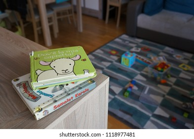 Poznan, Poland - December 30, 2015: Italian animal baby book and Polish child book about planes on wooden table
