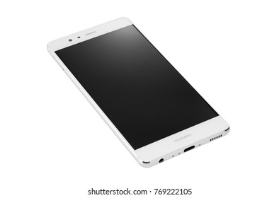 POZNAN, POLAND- December 6, 2017: White mobile phone smart phone Huawei P9 isolated on the white background