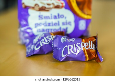 Poznan, Poland - December 8, 2013: Milka Crispello chocolate snack in small bags on a wooden table.