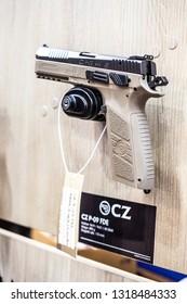 Poznan, Poland, Feb 02, 2019:  CZ Ceska Zbrojovka P.09 FDE, semi-automatic pistol made by Czech firearm manufacturer CZUB in Czech Republic, exposition at KNIEJE Hunting and shooting fair,