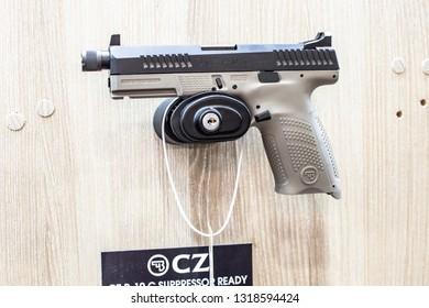 Poznan, Poland, Feb 02, 2019: CZ P-10 C Suppressor Urban Grey Cal.9 Luger, semi-automatic pistol made by Czech firearm manufacturer CZUB in Czech Republic, exposition, KNIEJE Hunting shooting fair,