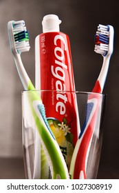 POZNAN, POLAND - FEB 14, 2018: Colgate toothpaste, a brand of oral hygiene products manufactured by American consumer-goods company Colgate-Palmolive