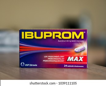 Poznan, Poland - February 28, 2018: Polish USP Zdrowie Ibuprom Max pain killer pills in a box on wooden table