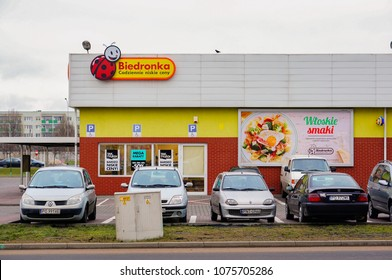 Poznan, Poland - January 25, 2015: Parked cars in front of a Biedronka supermarket