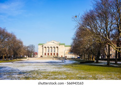 POZNAN, POLAND - JANUARY 27, 2017: Frozen pond on a park in front of the Grand Theatre building on a cold winter day