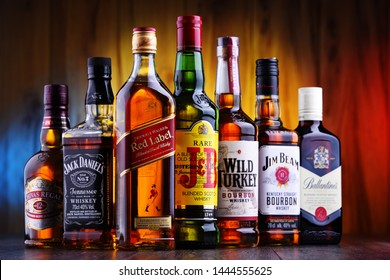 POZNAN, POLAND - JUL 5, 2019: Bottles of several global whiskey brands, the most popular liquor in the world.
