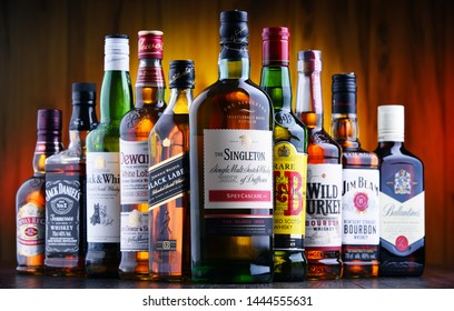 POZNAN, POLAND - JUL 5, 2019: Bottles of several global whiskey brands, the most popular liquor in the world.