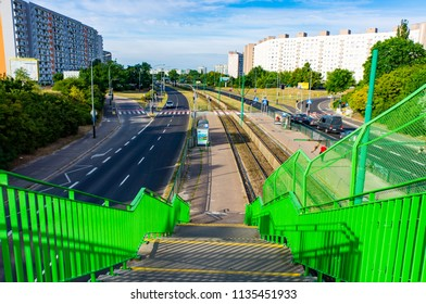 Poznan, Poland - July 10, 2018: Stairs leading to a tram stop close by a main road and apartment buildings