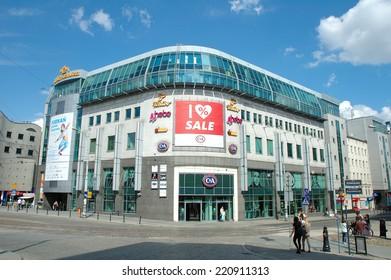 Poznan, Poland - July 13, 2014: Kupiec Poznanski shopping centre, and unidentified people on Wiosny Ludow square in Poznan, Poland.