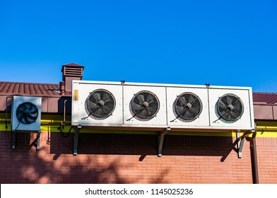 Poznan, Poland - July 20, 2018: Outdoor units of split-system air conditioners of a Biedronka supermarket on the Stare Zegrze district