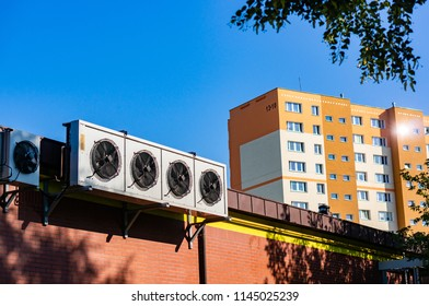 Poznan, Poland - July 20, 2018: Outdoor units of split-system air conditioners of a Biedronka supermarket with a apartment block in the background on the Stare Zegrze district