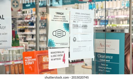 Poznan Poland - July 27, 2021: Dr Zdrowie pharmacy in mall M1. Entrance to drugstore in polish mall. COVID pandemic restrictions, social distance and wearing masks