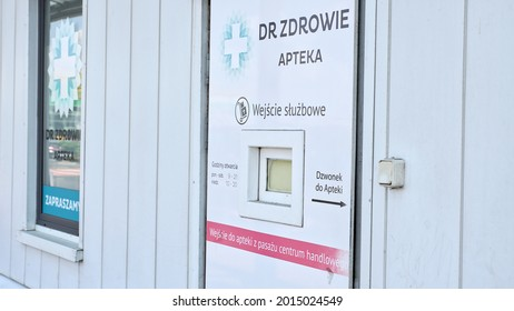 Poznan Poland - July 27, 2021: Backdoor entrance to pharmacy dr. zdrowie in polish mall M1. Door with small window on back of drugstore in Poland.