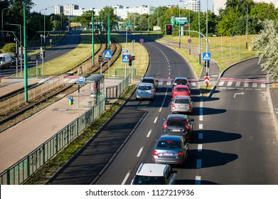 Poznan, Poland - July 4, 2018: Row of cars waiting in front of red traffic lights on a main road close by the Stare Zegrze district