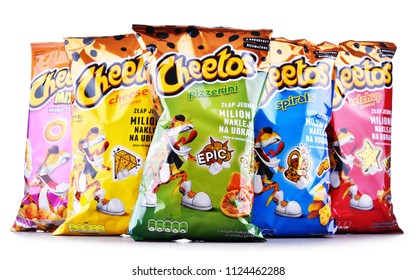 POZNAN, POLAND - JUN 15, 2018: Packets of Cheetos, a brand of cheese-flavored puffed cornmeal snacks made by Frito-Lay, a subsidiary of PepsiCo.