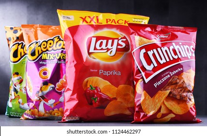 POZNAN, POLAND - JUN 15, 2018: Packets of popular brands of snack food including Lays, Crunchips and Cheetos