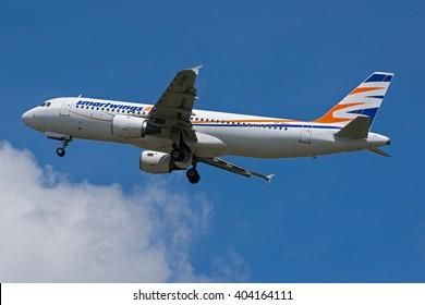 POZNAN, POLAND - JUNE 1: Travel Service Hermes Airlines Airbus A320 (registration SX-BHV) at Poznan Lawica Airport - POZ. June 1, 2014.