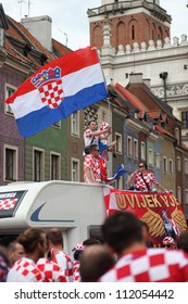 POZNAN, POLAND - JUNE 10: Croatia football team supporters cheering and waving flag before the match on June 10, 2012 in Poznan, Poland.