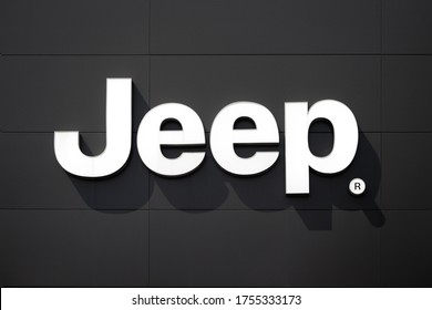 POZNAN, POLAND - JUNE 11, 2020. Jeep logo with a muted black background. Jeep is an American car manufacturer producing SUVs and off-road vehicles.