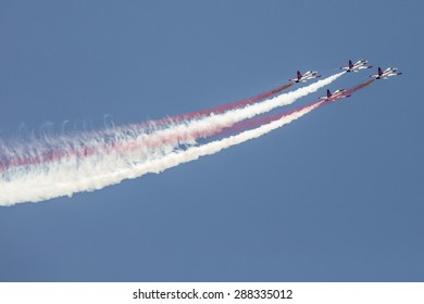 "POZNAN, POLAND - JUNE 14: Aerobatic group formation ""Turkish Stars"" at blue sky during Aerofestival 2015 event on June 14, 2015 in Poznan, Poland"