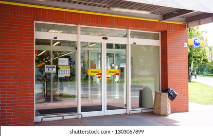 Poznan, Poland - June 22, 2014: Entrance to a Biedronka grocery supermarket with closed automatic doors. Store is a popular national chain.