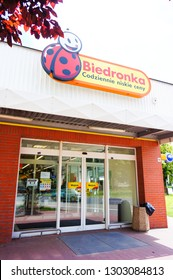Poznan, Poland - June 22, 2014: Front entrance of a Polish Biedronka grocery supermarket with automatic doors and sign. Store is a national popular chain.