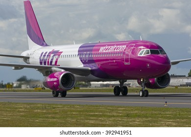 POZNAN, POLAND - JUNE 22: Wizz Air Airbus A320 (registration HA-LYD) on Poznan Lawica Airport - POZ. June 22, 2014.