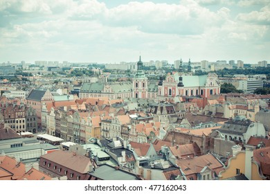 Poznan, Poland - June 28, 2016: Vintage photo, View from tower on old and modern buildings and collegiate church in polish city Poznan
