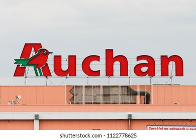 POZNAN, POLAND - JUNE 28, 2018. The logo of Auchan - French international retail group operating hypermarkets and supermarkets chain.