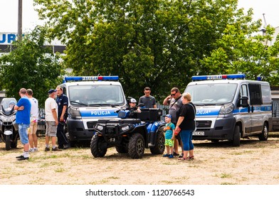 Poznan, Poland - June 9, 2018: Children and adults by a Police four wheels scooter during the Bezpieczne Wakacje event on the local fire department area