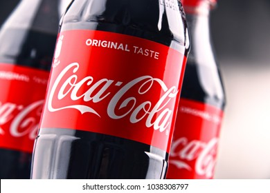 POZNAN, POLAND - MAR 1, 2018: Plastic bottles of Coca-Cola, a carbonated soft drink manufactured by The Coca-Cola Company headquartered in Atlanta, Georgia, USA