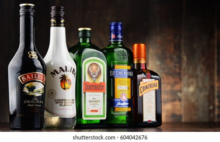POZNAN, POLAND - MAR 16, 2017: Historical descendants of herbal medicines, liqueurs are drinks made from distilled spirit flavored with fruit, cream, herbs, spices, flowers or nuts and added sugar
