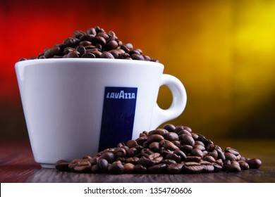 POZNAN, POLAND - MAR 29, 2019: Cup of Lavazza coffee, a brand owned by an Italian manufacturer of coffee products, founded in Turin in 1895 by Luigi Lavazza.