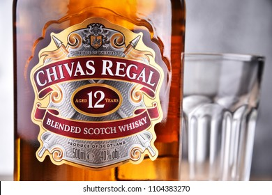POZNAN, POLAND - MAR 30, 2018: Bottle of Chivas Regal 12, a blended Scotch whisky made from whiskies matured for at least 12 years, produced by Chivas Brothers in Keith, Scotland