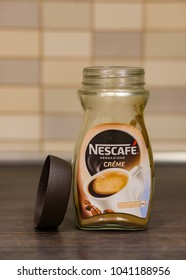 Poznan, Poland - March 08, 2018: Almost empty opened Nescafe Sensazione Creme glass jar with instant coffee on a wooden table