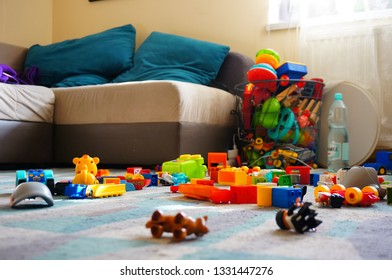 Poznan, Poland - March 2, 2019: Mix of Lego Duplo blocks laying around on a carpet floor in a living room with sofa.