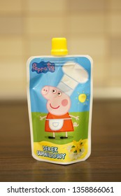 Poznan, Poland - March 26, 2019: Peppa pig vanilla dessert in a bag to go standing on a table.